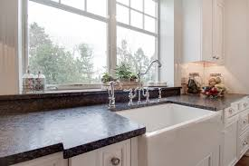 bright white kitchen with silver pearl leathered granite