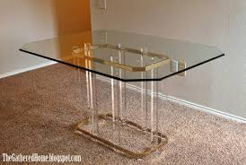 brass glass dining table found hollywood regency brass glass lucite tables the gathered