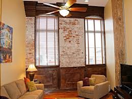 warehouse district new orleans condo trends by eric bouler 333 julia street 226 living exposed brick julia place condos
