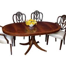 mahogany oval dining table and heart shield back chairs dining