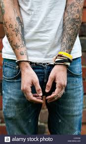 handcuffed teenager with tattoos stock photo royalty free image