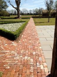 reclaimed brick path will do ours in herringbone pattern but like