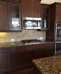 kitchen cabinets and backsplash kitchen cabinets american cherry glass subway tile backsplash