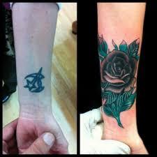 49 initials wrist tattoos