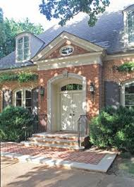 very symmetrical exterior with entry door front and center shut