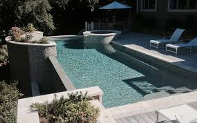 Infinity Pool Backyard by Curved Infinity Pool Spa Combo With Planters Aqua Blue Pools