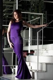 full length portrait of beautiful young woman in long black dress
