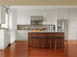 pictures of white kitchen cabinets with island crisp white kitchen meets rich wood cabinetry