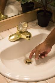 how to put sink stopper back in how to unclog a drain without chemicals or spending money