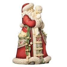 amazon com enesco heart of christmas santa holding child figurine