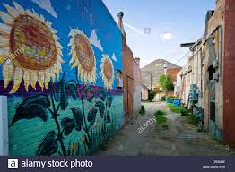 colorful murals painted on the brick wall of a building in colorful murals painted on the brick wall of a building in historic downtown district small mountain town of salida colorado