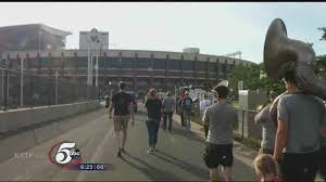 united fans pregame march to tcf bank stadium a growing tradition