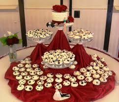 wedding cake with cupcakes on the side wedding cupcakes with