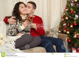 christmas decoration at home happy couple in christmas decoration at home new year eve