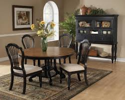 hillsdale wilshire round oval dining table rubbed black 4509 816