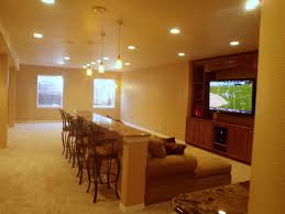 man cave table and chairs revisited man cave seating basement remodel with built in bar behind