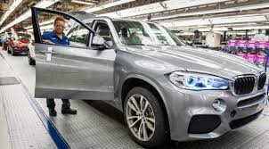 bmw car plant blasts bmw for er building almost 50 000 more cars in the