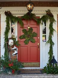 Christmas Decorations For Porch Columns by Decorating The Porch For Christmas With Natural Garland Sled Ice