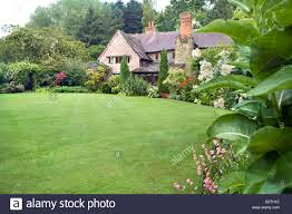 country cottage country cottage garden with large sweep of lawn and mixed