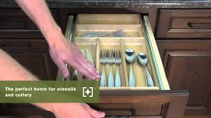schuler cabinetry three drawer base with cutlery divider kitchen