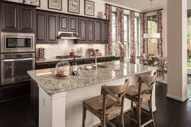 Kitchen Cabinets Austin Tx Sleek Subway Tiles And High Movement Granite Tie Together This