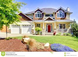 large american beautiful house with red door stock photography