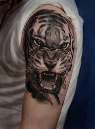 tiger on the left arm and