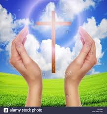 praying with cross in sky easter concept stock photo