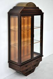wall mounted curio cabinet exotic rosewood and brass wall hanging curio cabinet at 1stdibs