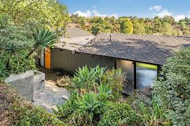 this midcentury home for sale is not your regular ranch house dwell