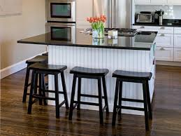 small black and white kitchen island with breakfast bar also built