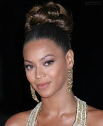 beyonce knowles with her worn up with curls in crown