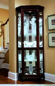 cherry corner curio cabinet cherry corner curio cabinet pulaski furniture chocolate present with