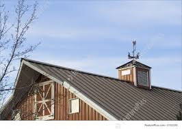 red barn with metal roof photo