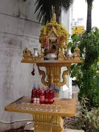 tim in phuket red pop and thai buddhist shrines