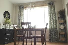 large window mixed with ikea curtains in floral motifs also wooden