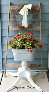 organized clutter how to add vertical interest to the flower garden