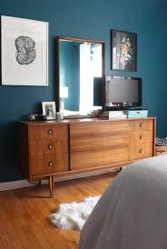 mid century moody bedroom the reveal teal walls dark teal and