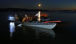 kayak lights for night paddling sea kayakers paddle at night where the plankton shines the