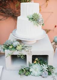 succulent wedding cake and cinderblock cake stand deer pearl flowers