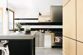 black backsplash in kitchen trend 20 ways to add stripes to your kitchen