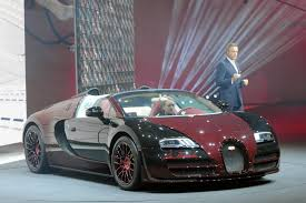 latest bugatti first and last bugatti veyron built share the stage in geneva