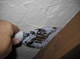 Asbestos Popcorn Ceiling Year by Covering A Popcorn Ceiling With Plaster Dengarden
