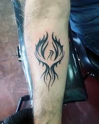 unique tattoo trends inner forearm black ink male phoenix tattoo