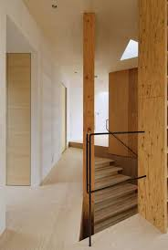 steep slope house with bookshelf lined interior