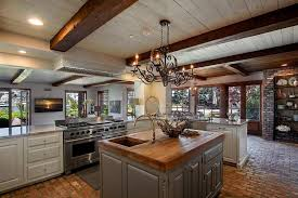 kitchens with islands designs grey kitchen island design using wooden countertop and wooden beam