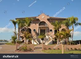huge three story mediterranean waterfront mansion stock photo