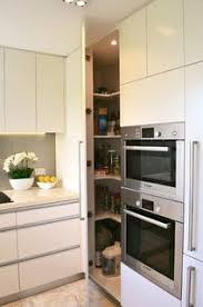 kitchen pantry ideas small kitchens two ovens in vertical alignment with pantry door alongside to the