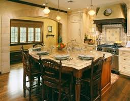 Kitchen Island With Oven by Fireplace White Thomasville Cabinets With Cream Countertop And