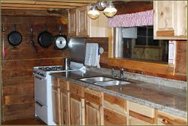 large brown wooden kitchen cabinet with stove also white counter